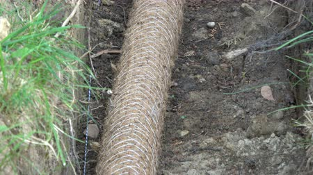 kanalizace : drainage trench with pipe on field