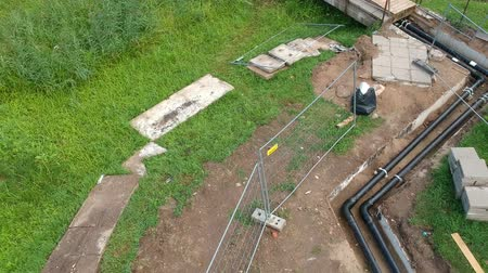 boru hattı : Heating system repair trench and pipeline in park from drone, aerial