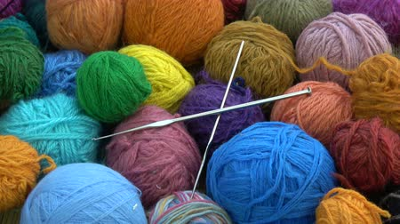 haft : Rotating many  yarn wool balls with two metal knitting crotchets Wideo