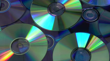 compact disc : Rotating colorful shiny many DVD and CD compact discs background Stock Footage