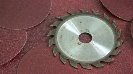 sand paper : Sandpaper abrasive polish discs rotating background and steel circular saw