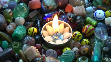 naszyjnik : Rotating indian beads background with  lotus candle blowing light Wideo