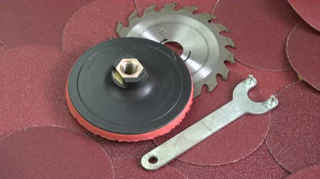 sand paper : Rotating sanding discs and circular saw tool  background
