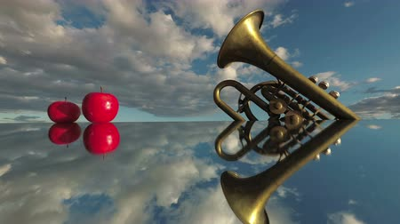 trąbka : Music concept. Brass wind instrument and red apples on mirror and clouds motion in space, time lapse