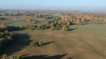 Литва : Beautiful autumn nature park with farm fields landscape, aerial view