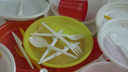 ware : Rotating  colorful plastic disposable tableware dishware background