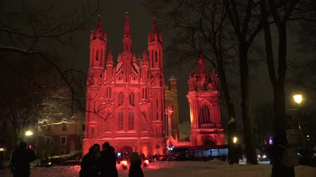 art : Vilnius light festival, Church of St. Anne in red light and peoples, 2019