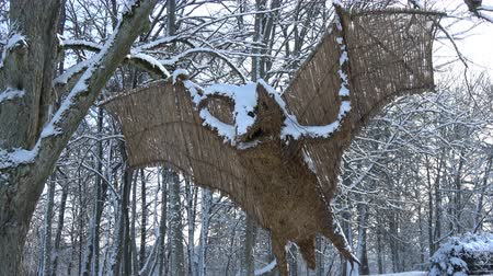 kamış : Beautiful big handmade decorative bat from straw and reeds in winter nature park