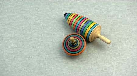 retorcido : Two wooden colorful top spin whirligig on new table background