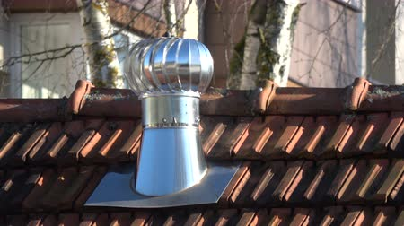 ventilátor : New metal chimney with ventilator in wind on roof