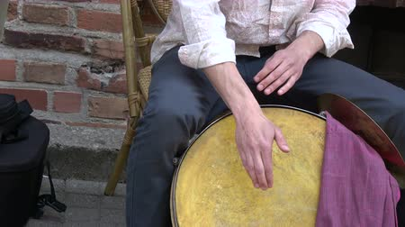 percussão : Musician drummer hands playing with big drum in street