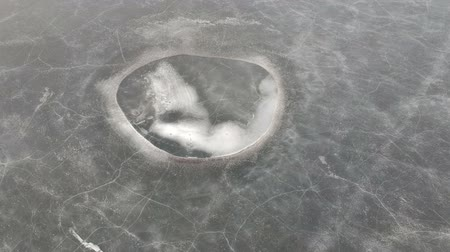 割る : Cracked last spring lake ice background, aerial view