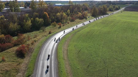 closing : Motorcycle Bikers column on the autumn road, closing of the season, aerial view