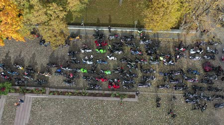litvanya : Many motorcycle bikers in small town square, closing of the season, Lithuania, aerial view Stok Video