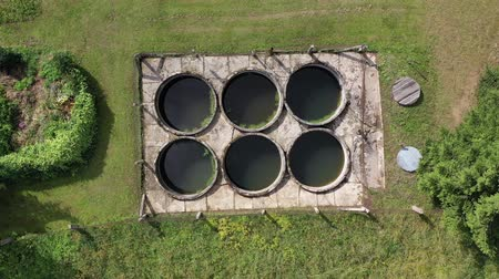 primitív : Small primitive sewage treatment plant in province village, aerial view Stock mozgókép