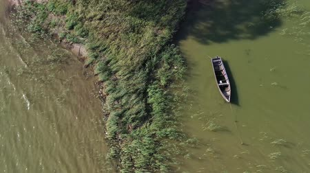 Литва : Lonely old wooden fishing boat on sea water, aerial view Стоковые видеозаписи