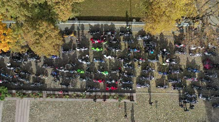 litvanya : Big group motorcycle bikers in town square, closing of the season, Lithuania, aerial view Stok Video