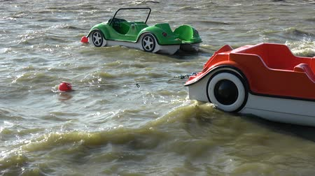 remo : Two Plastic colorful boats in shape of cars on sea water waves Vídeos