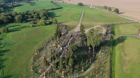 crucifixo : Lithuanian pilgrimage site iconic hill of crosses near Siauliai, aerial view Stock Footage