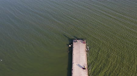 dalgakıran : Pier breakwater on sea lagoon with fishermens, aerial view