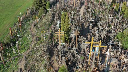 crucifixo : Hill of crosses near Siauliai, Lithuania, aerial view Stock Footage