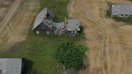 parasztház : Old wooden farm house ruins, aerial view Stock mozgókép