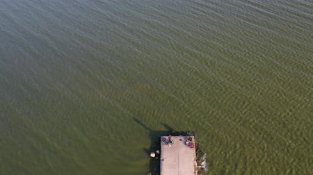 dalgakıran : Concrete Pier breakwater on sea lagoon with fishermens, aerial view Stok Video