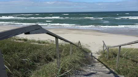 baltık denizi : Wooden stairs on beach dune and Baltic sea waves Stok Video