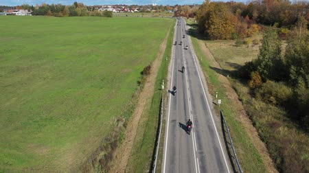 litvánia : Motorcycle Bikers column on asphalt road near city, closing of the season, aerial view Stock mozgókép