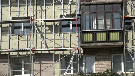 Old flat house renovation and insulation work place with scaffolding Stock mozgókép