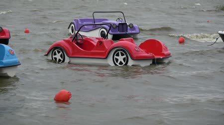samochód : Plastic  boats in shape of cars group on sea waves