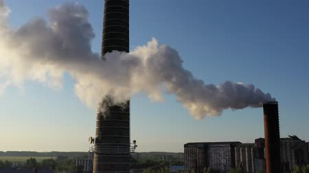 poluir : Smoke from boiler house chimney on blue sky background, aerial view