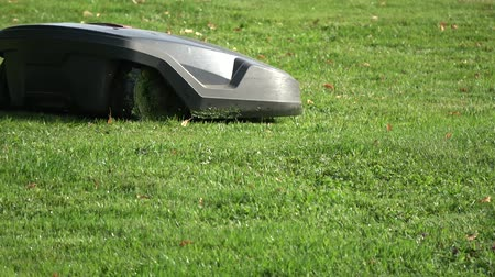 android : Robot cut grass - Futuristic modern robotic lawn mower at work