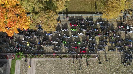 closing : Many motorcycle bikers in town square, closing of the season, Lithuania, aerial view