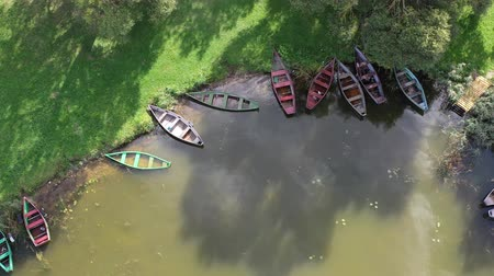 Drone  above old wooden fishing boats group on lake coast, aerial view 動画素材