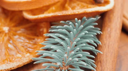 Christmas background: dried oranges, anise stars, cinnamon sticks, sprig of spruce.Close-up
