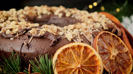 клюква : Festive Christmas cupcake with orange slices and nuts on the background of a New Years garland. Circle motion