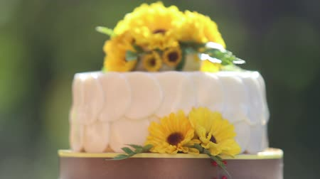 wedding cake : white creamy cake decorated with yellow chrysanthemum flowers