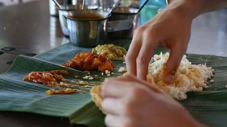 pani : white man eats with his hands indian food from banana leaf like indian people