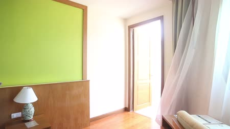 daireler : panorama of waving by wind window curtains in double bed hotel room