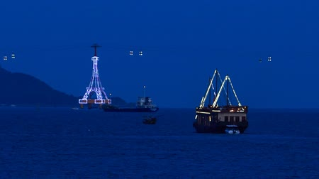 kopec : panorama of drifting tourist ship in lights along bay at night at background of ropeway and lightship