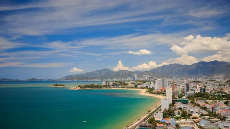 Вьетнам : panorama of Vietnamese resort city and azure sea at background of mountains and white clouds in blue sky