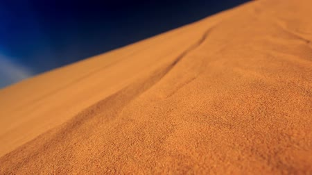 crest dune : closeup camera moves along yellow quicksand in white sand dunes