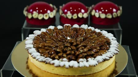 kaplanmış : homemade almond coated tart lie against red glazed dessert