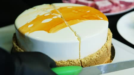 nádivka : closeup confectioner hands cut by knife white mousse cake
