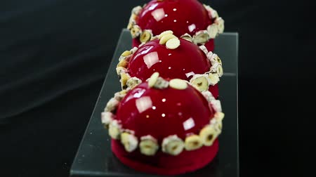 galaretka : focus in on three decorated red mousse desserts