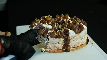 stuffing : confectioner hands cut by knife double layer Kiev cake