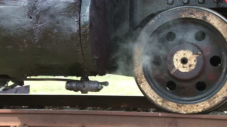 iron pipe : Steam locomotive detail as engine departs Stock Footage