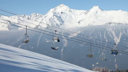 esqui : Ski lift on mountains background. Bormio, Italy