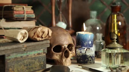 готический : Dolly shot of a alchemy still life with skull